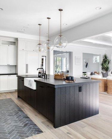 black kitchen island with black countertop
