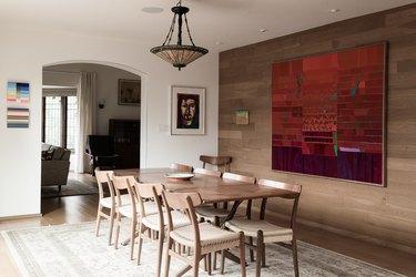 Dining room dining room lighting idea with art on wall