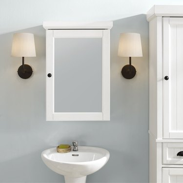 bathroom medicine cabinet with molding and distressed white finish