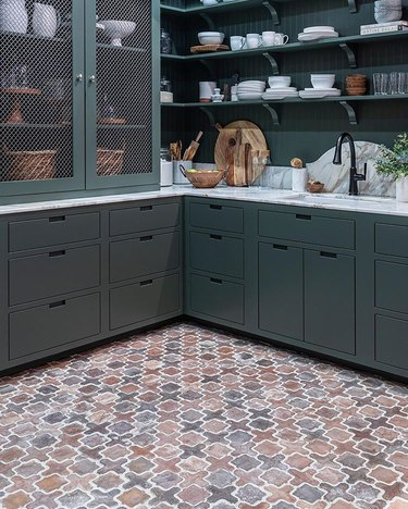 kitchen with tile floor and dark cabinets