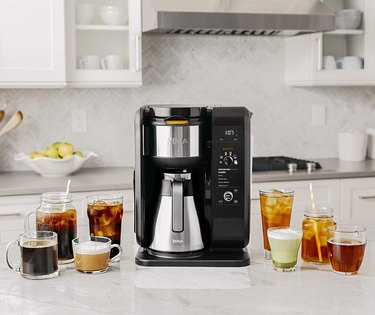 Black coffee maker with stainless steel carafe and eight different drinks