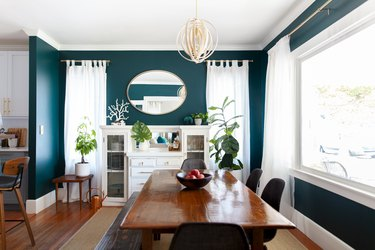 bright green dining room color idea with wood flooring and dining table