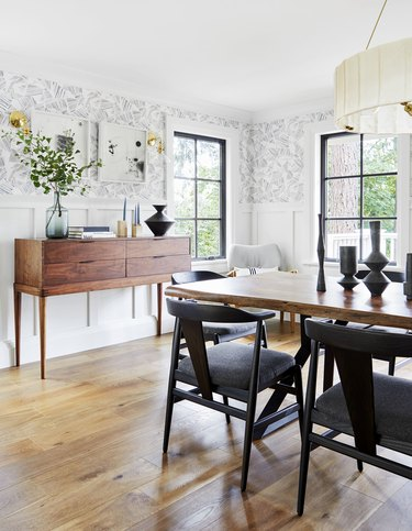 modern dining room with mixed wood finishes and credenza for storage