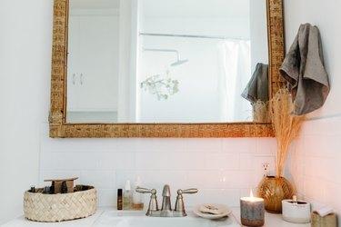 bathroom sink with wood frame mirror