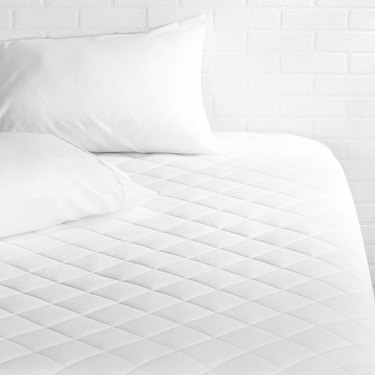 AmazonBasics Hypoallergenic Quilted King Mattress Pad, $25.99
