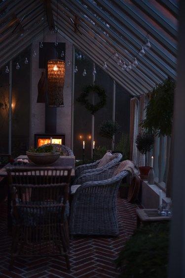 Swedish greenhouse with wood stove fireplace