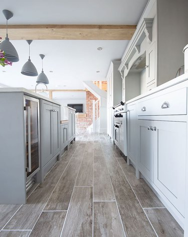 kitchen space with gray floor and gray cabinets