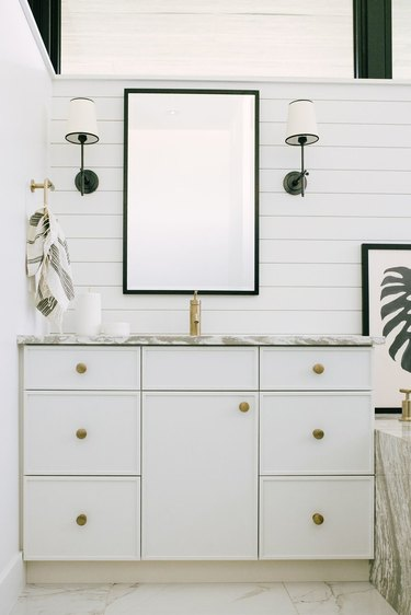 White Bathroom Cabinets by Jaclyn Peters Design