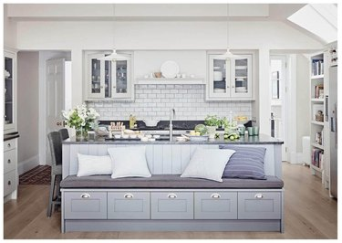 gray kitchen island with bench seating and built-in storage