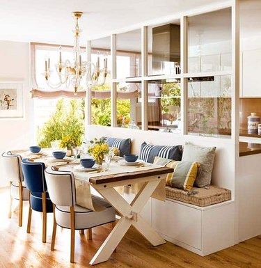 kitchen island with bench seating in coastal chic barcelona apartment