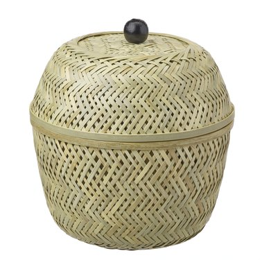 woven basket with black round handle