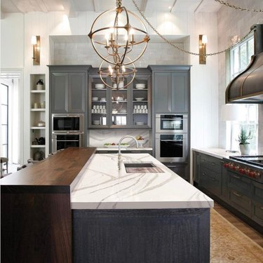 two tier kitchen island with wood and quartz countertop