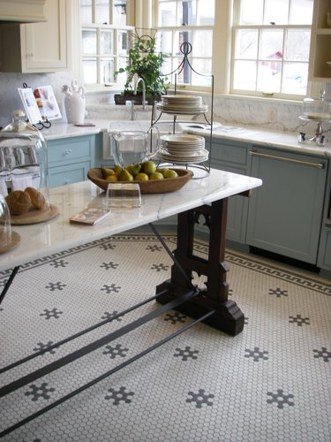 kitchen with island and cafe mosaic style flooring