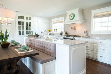 kitchen island with bench seating in traditional white kitchen
