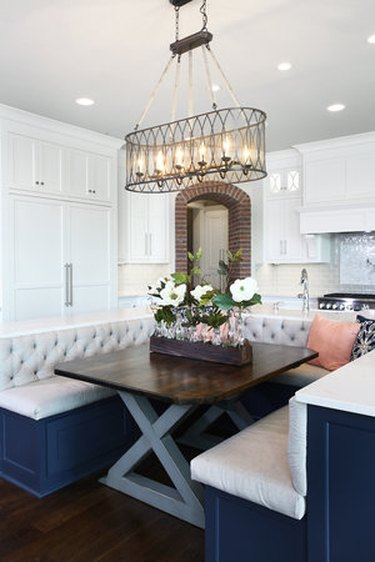 U-shaped kitchen island with bench seating in traditional kitchen
