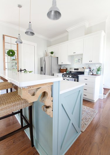 two tier kitchen island with blue base and white countertop