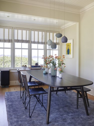Dining room with ceramic pendant lighting, Swedish dining set, and wall of windows