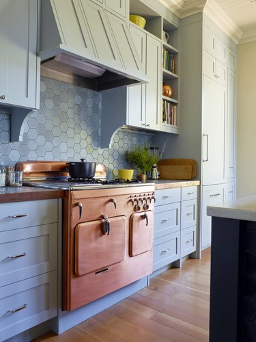 1950 Chambers copper stove with chrome details in powder blue kitchen with hexagon backsplash