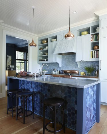 Contemporary kitchen with different shades of blue hexagon heath tile and kitchen island