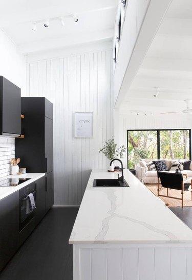 Black kitchen floor in white galley kitchen