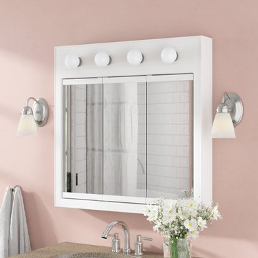 medicine cabinet with vanity lighting