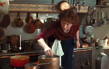 "Meryl Streep as Julia Child cooking in ""Julie & Julia"" with a Le Creuset on the stove"
