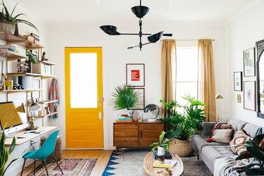 living room with yellow front door