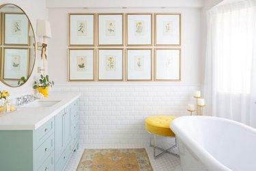 light blue bathroom cabinets in white bathroom