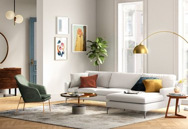bright modern living space with white couch and colorful accents