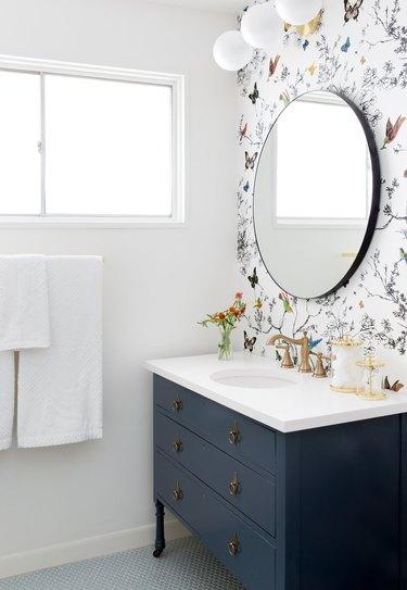 vintage blue bathroom cabinets with floral wallpaper