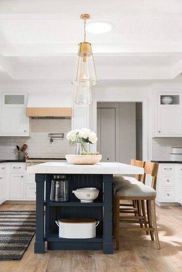 dark blue beadboard kitchen island with white countertop