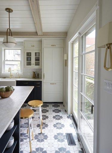 white luxury kitchen with blue kitchen floor tile