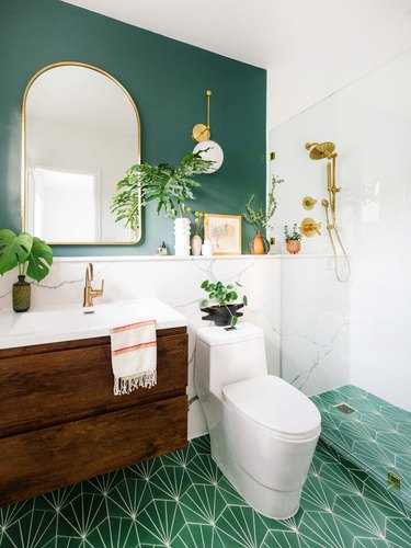 Green boho room with patterned tile floor and green accent wall