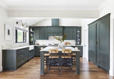teal kitchen island with shaker cabinetry