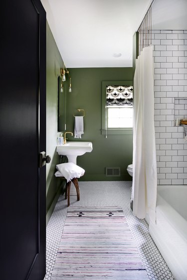 green bathroom idea with white subway tile shower