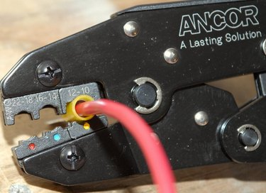 Crimping a wire connector.
