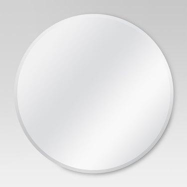 Frameless round wall mirror