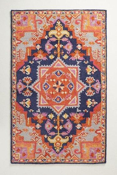 Vibrant orange, pink, and navy blue variegated area rug