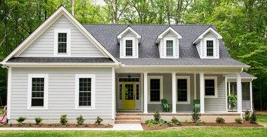 farmhouse style exterior with white rails