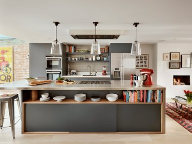 Kitchen island back panel idea with storage space by Roundhouse Design