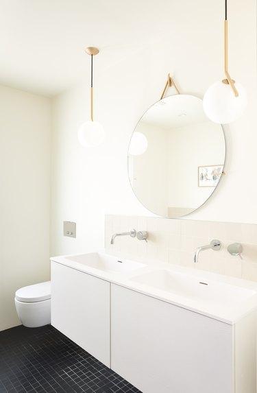 white bathroom with pendant lighting