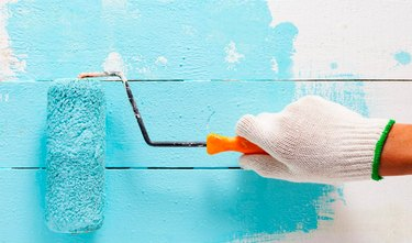 Using a paint roller.