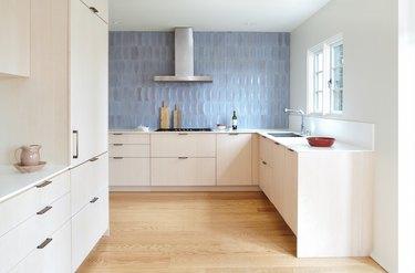 kitchen with blue tile backsplash