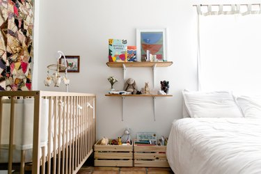 Bed and crib in bedroom