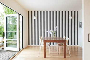dining room with striped wallpaper