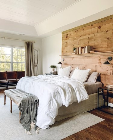 rustic bedroom lighting ideas with DIY wood feature headboard with black wall sconces