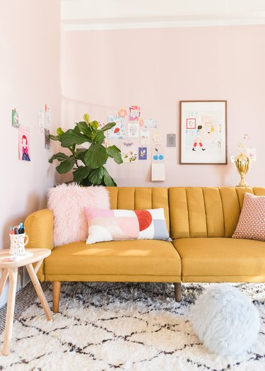 pink living room with channel tufted sofa