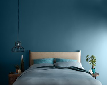 bedroom with blue wall