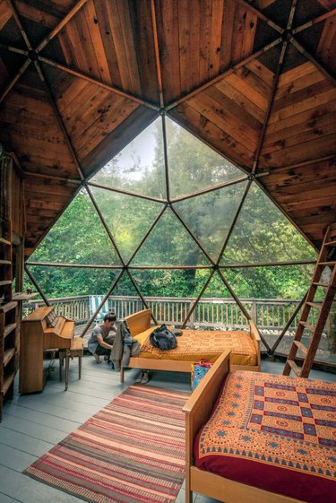 cabin interior with geometric dome roof and windows