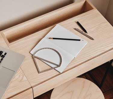 overhead shot of a table with paper and pencils